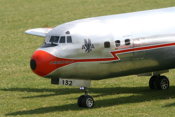 Carl Bachhuber's Lockheed Electra II fly by, carl bachhuber, lockheed, 4-engine electra II, 4 evolution 26cc gas engines, tuned pipes robart retracts traditional balsa, plywood, model airplane news, front of plane, pic 1, AMA