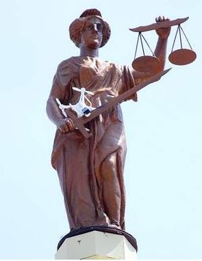 "Lady Justice ""catches"" a quad"