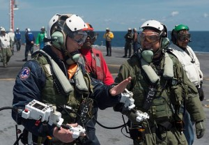 Dave Lorenz, left, and Bruce McFadden, deck operators for Northrop Grumman, discuss the launch of an X-47B Unmanned Combat Air System (UCAS) demonstrator on the flight deck of the aircraft carrier USS George H.W. Bush (CVN 77). Lorenz and McFadden operated the X-47B as it taxied from the aircraft elevator to the catapult. George H.W. Bush is the first aircraft carrier to successfully catapult launch an unmanned aircraft from its flight deck. (U.S. Navy photo by Mass Communication Specialist 2nd Class Timothy Walter/Released)