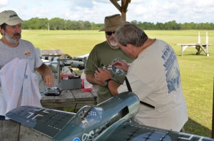 Robert is wiping the P-51,s residue from his face, as Jerry inspects the aricraft for damage AFTER crashing into Robert!