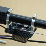 The tail servo mount positions the servos directly under the tail boom for easy routing of the pushrods.