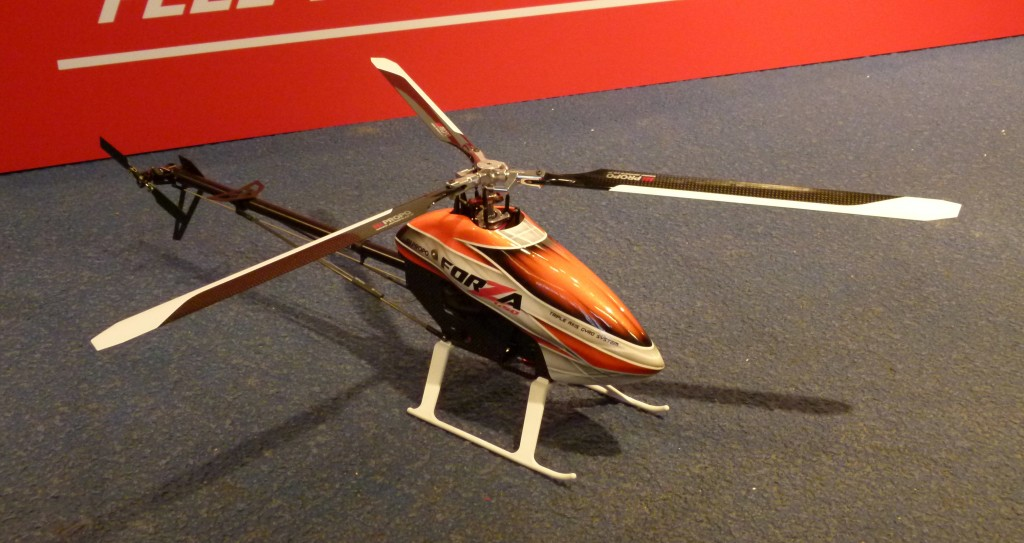 JR's booth featured their brand-new 3-bladed version of the outstanding Forza 450.  The rigid damperless head brings the advantages of the larger 3-bladed NEX to a 450-size package.  This heli is a beauty.