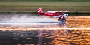 A World Models 1/3 scale Cub skims the water at Joe Nall 2015.