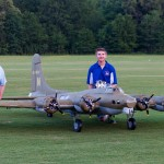 """Father and son team Victor and Max Moxey pose with their 210"""" foamy B-17."""