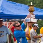David Payne hold the Bob Smith trophy high