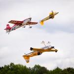 Aerobatic Trio Doing Some Tight Maneauvers