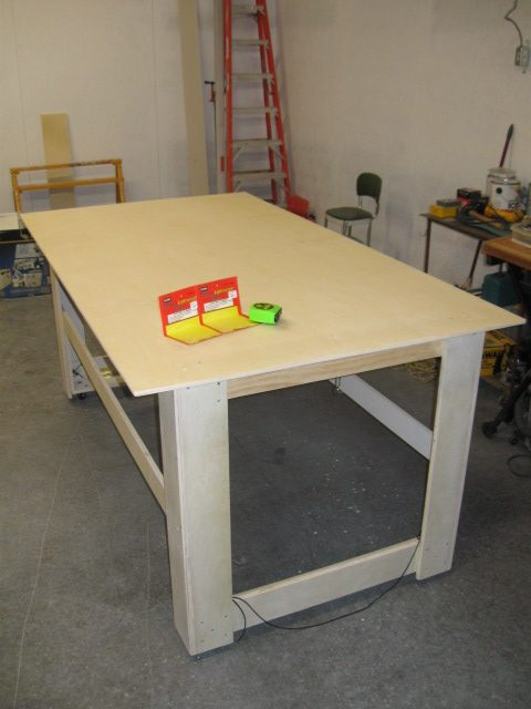 Table lifted up and the hinged side stops dropped into position. Table can now be moved about as needed.
