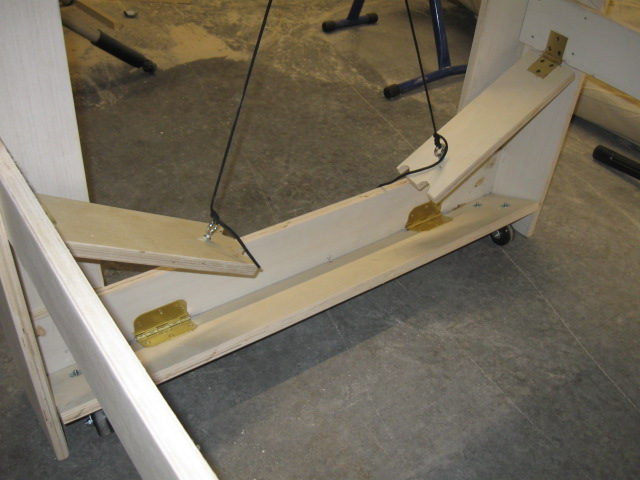 Once you get the wheels and cross braces installed on the narrow ends, you can flip the table upright. Now, you can lift the table up and drop the wheels down-and-locked and roll her around.