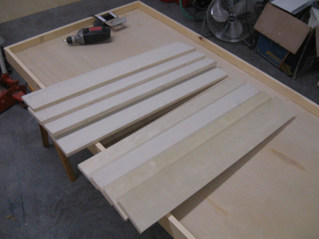 Cut-to-length plywood panels for the legs. Now is the time to change your mind on the height of the table! Ha. Also, level the exterior door on the sawhorses in both directions now.