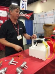 Bill Leonard with his brand-new fueler designed especially for RC plane use. 3-gallon capacity, easy-carry handle, works w tih gas, glow and smoke oil, CNC-machined hardware, and you can even lean on it because it's very sturdy and incredibly strong.
