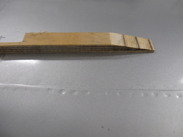 Above two images: View of the wedge construction to offset the door to the slope of the wing at the leading edge. Piece is trimmed off after installing.