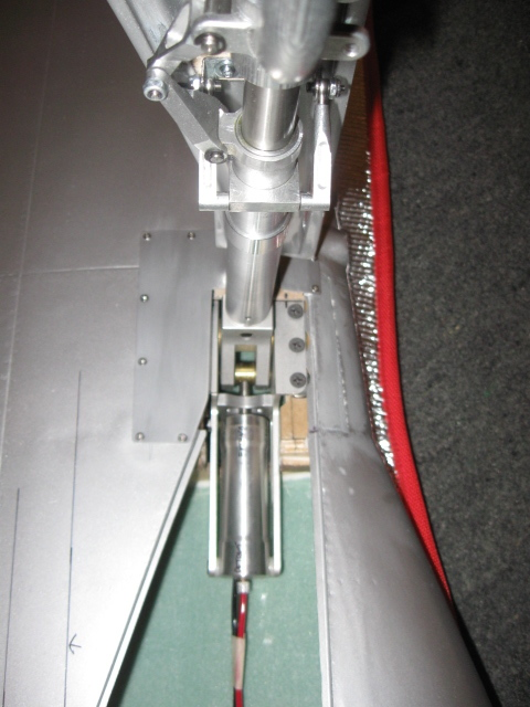 When properly setup, the collar holding the turnbuckles should be square to the door as shown here. If you are forced to skew it around to make the door fit the opening when the gear is retracted, then your hinge is likely installed wrong.