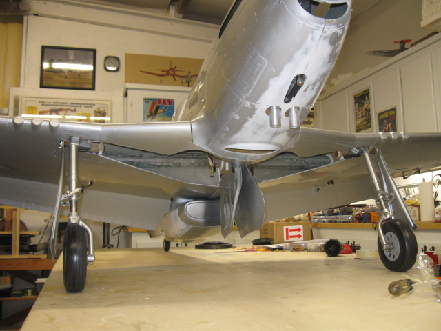 Here is the P-51 on the gear, but still in need of a paint scheme. Of course, the inner doors remain closed if air pressure is present, using the Ultra Precision 2 air control valve. But, between flights, it looks cool to bleed the air off the tank and drop them down as on the full-scale P-51 when parked. Once you have done the scale doors successfully, you won't have near the trouble the next time out. There is a learning curve for sure, but the same principles apply to installing the inner and outer gear doors on most Warbirds.